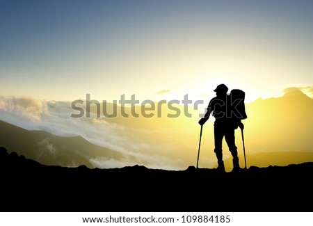 Silhouette of tourist in mountain. Sport and active life