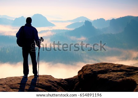 silhouette of tourist with...