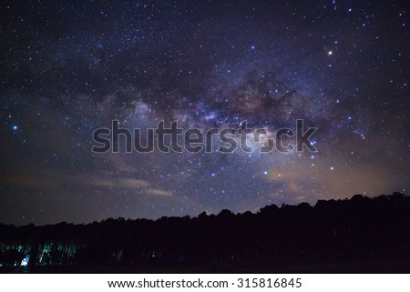 Silhouette of Tree with cloud and Milky Way. Long exposure photograph,with grain