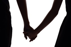 silhouette of two lovers hold hands together. Isolated on white background