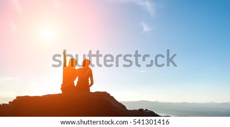 silhouette of two young women...