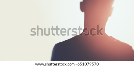 silhouette of unknown man with sun flares Foto d'archivio ©