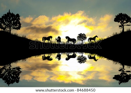 Silhouette of wild animals reflection in water