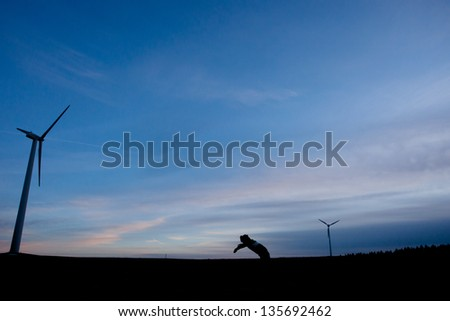 silhouette of wind power mills
