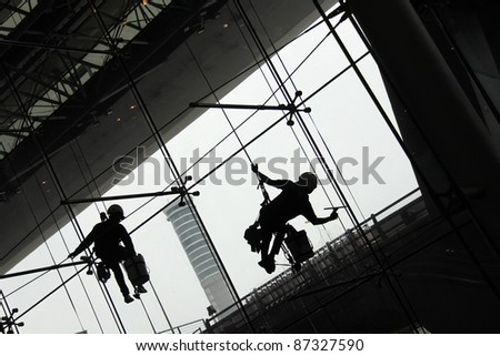 silhouette  of Window Cleaners (Window washers) working
