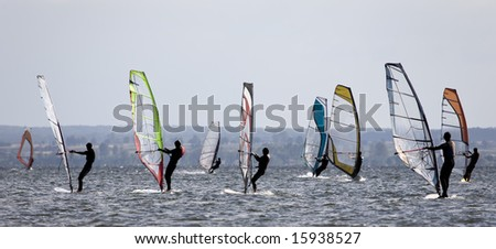 Silhouette of windsurfers on a gulf