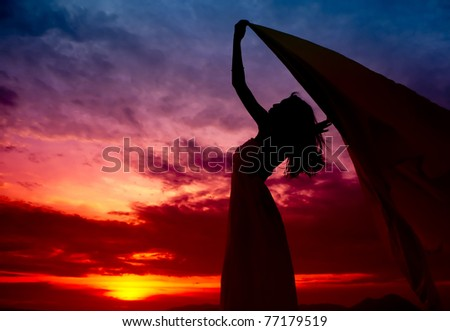 Silhouette of woman enjoy the sunset