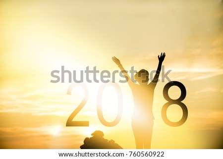 Silhouette of woman happy in holiday with New year 2018. Concept in sunset freedom background. #760560922