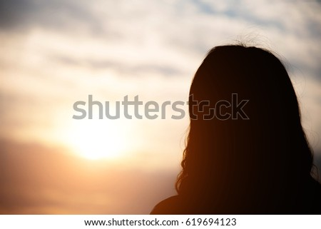 silhouette of woman in sunset , relax concept #619694123