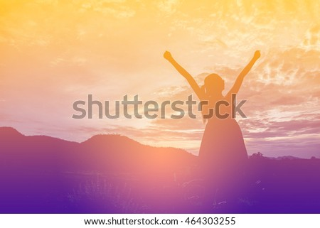silhouette of woman pointing with finger in sky  #464303255