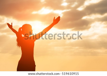 silhouette of woman pray with sunlight #519610915