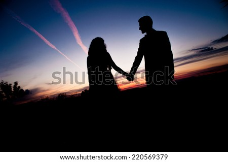Silhouette of Young couple in love bride and groom posing in a field on  beautiful sky ba7d7421da