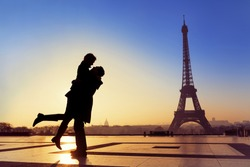 Silhouette of young couple in love with Eiffel Tower background in Paris, France