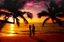 Silhouette of Young Couplestanding at the beautiful sunset on a tropical beach