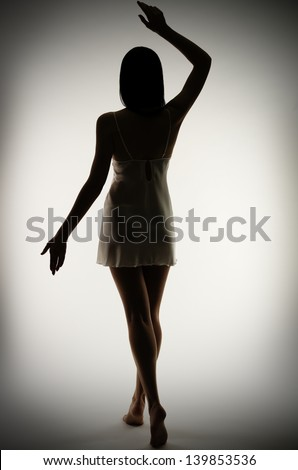 Silhouette of young girl on gray background