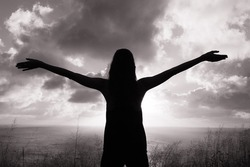 Silhouette of young girl outdoor. Freedom concept.