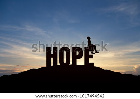 Silhouette of young man and the word