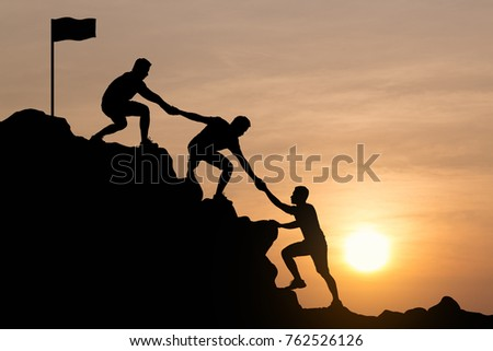 silhouette of young man helping ...