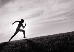 Silhouette of young man running