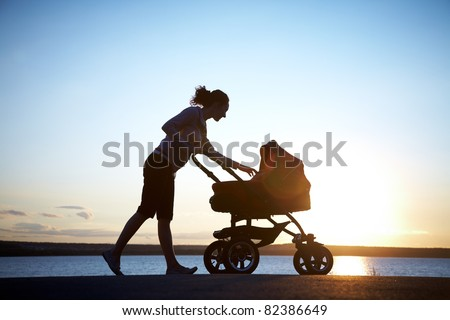 Silhouette of  young mother enjoying motherhood