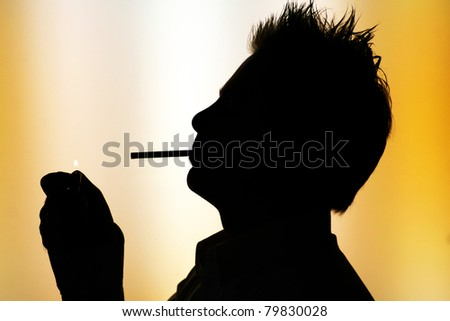 silhouette of young smoking man on white yellow  background -  back-lighting