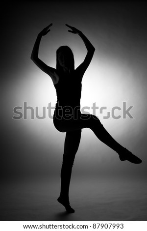 Silhouette of young woman in dance pose