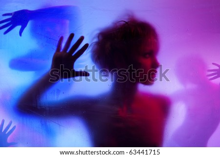 Silhouette  of young woman listening standing behind curtain