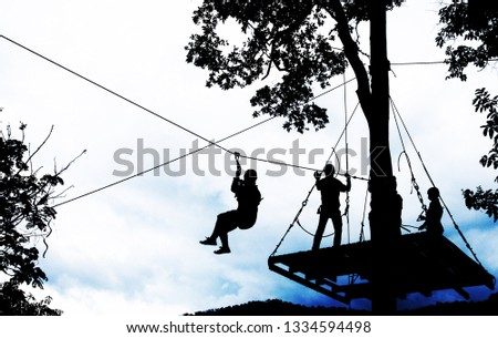 silhouette of zip line #1334594498