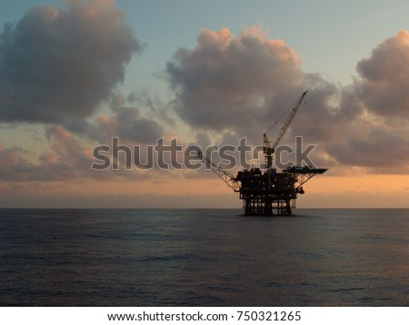 silhouette offshore platforms with cloudy sky on sunrise background #750321265