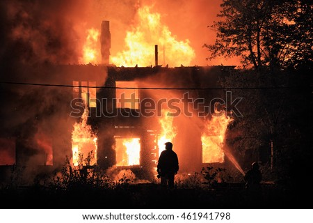 silhouette on housefire background
