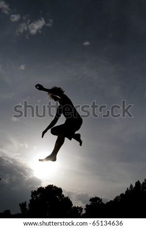 silhouette on trampoline jumping