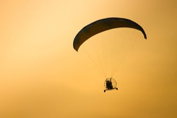 silhouette paramotor flying /sunset time