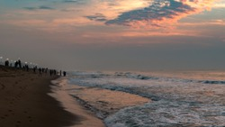 Silhouette People at Puri Beach at the time of Sunrise.