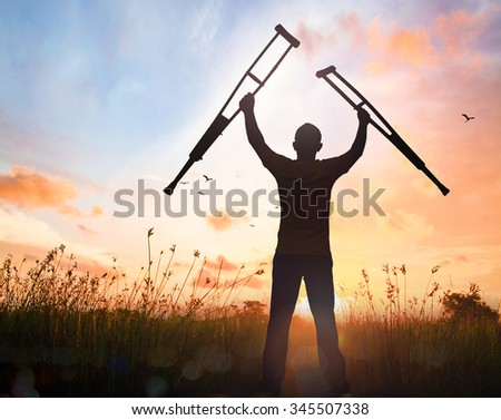Silhouette people disabled man stand up meadow mountain sunset background Handicapped Disability Recovery Healing Helper Health Care Insurance Agent Victory Sick Fulfillment Final Decision concept