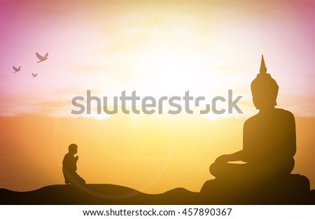 Silhouette people pray from buddha statue to hope for help on sun set and bokeh background. Inspiration from help to hope for Vesak Day or Wesak, Jayanti day or Visakha Bucha day