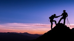 silhouette picture teamwork man helping hand friend to top of mountain successful with mountain background copy space twilight time