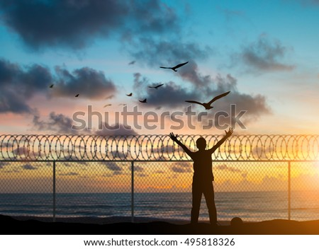 silhouette prisoners were imprisoned on the island alone, praying and free bird fly over blurred nature sunset background. hope and people concept and international day of peace. #495818326