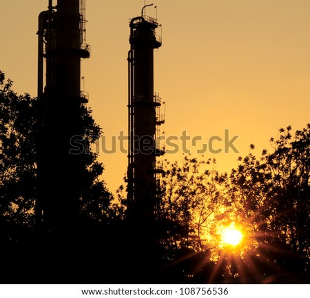 silhouette refinery Column in sun set Theme