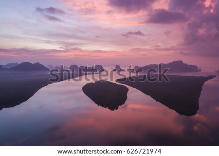 Silhouette rock mountain in sunrise time at Phang-Nga bay southern of Thailand. Aerial view from flying drone. #626721974
