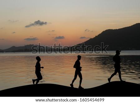 Silhouette running exercise n the evening atmosphere Sunset. Stock fotó ©