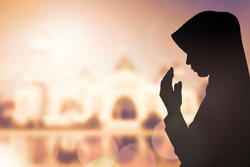 Silhouette sad muslim woman prayer wear hijab fasting pray to allah on mosque arabesque background concept abstract islamic pakistan girl hands on peace and humility, arabic calendar in eid mubarak.