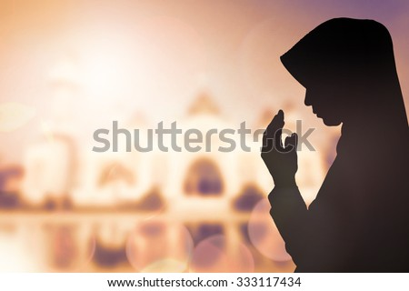 Photo of  Silhouette sad muslim woman prayer wear hijab fasting pray to allah on mosque arabesque background concept abstract islamic pakistan girl hands on peace and humility, arabic calendar in eid mubarak.