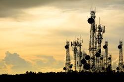silhouette satellite dish telecom network at sunset communication technology network