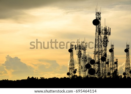 silhouette satellite dish telecom network at sunset communication technology network #695464114