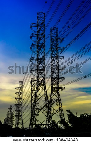 silhouette shot of Electricity pylons