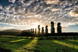 Silhouette shot of Moai statues in Easter Island, Chile sunrise