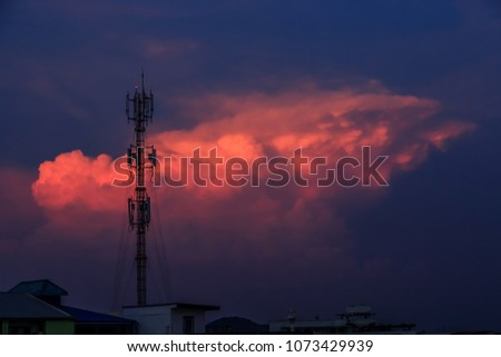 Silhouette signal antenna tower at beautiful sunset sky background
