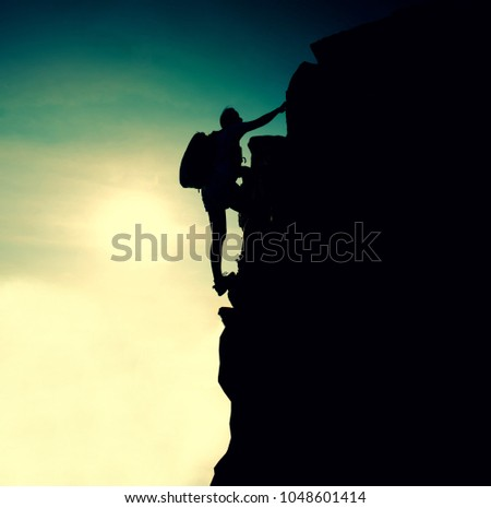 Silhouette sporty woman on the cliff. Sunset and high mountain. Business Success and goal. Personal development concept.