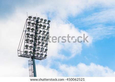 Silhouette stadium light and blue sky