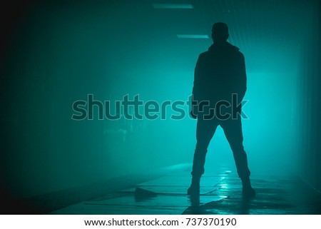 Silhouette standing man with in the darkness #737370190